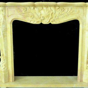 Скульптура из мрамора: Каминный портал из мрамора желтого цвета
