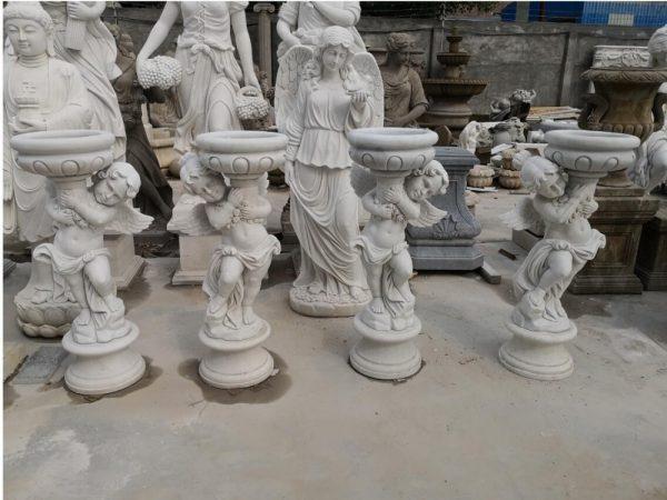 Скульптура из мрамора: Мраморные горшки для сада