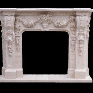 Скульптура из мрамора: Каминный портал из мрамора молочного оттенка